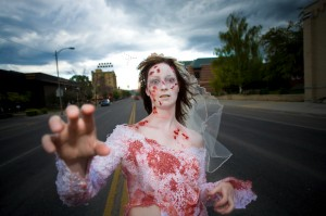 NICK WOLCOTT/CHRONICLE  Jessi Sparkman, organizer of this year's Zombie Walk, poses in her zombie costume on Main Street Saturday evening.